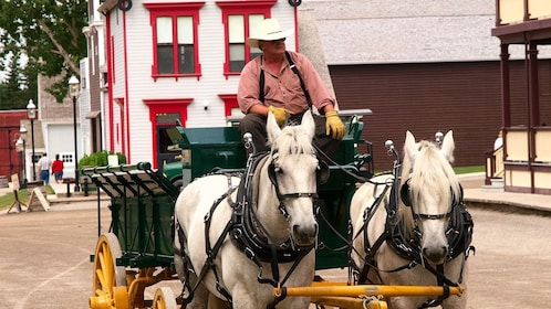 Man on a horse drawn cart at the Heritage Park Historical Village in Calgary