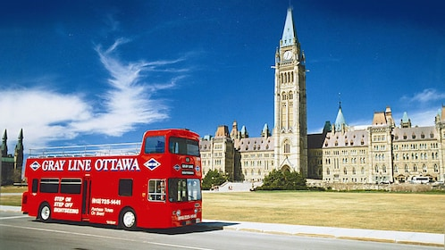 Hop-On Hop-Off bus in front of the Centre Block and Peace Tower in Ottawa