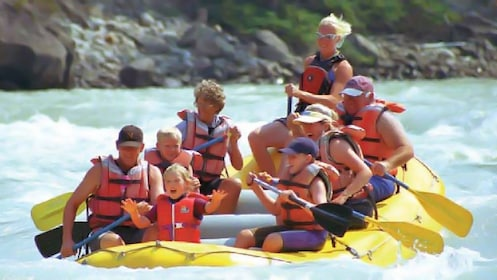 Group excitedly rafting down the Athabasca River