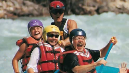 Close up view of guests enjoying their time rafting down the Athabasca River