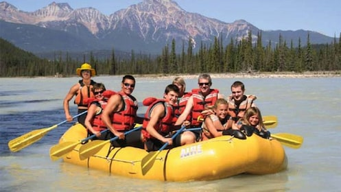 Group smiles for camera aboard the raft rafting down the Athabasca River
