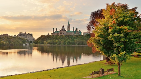 The Ottawa River and Parliament Hill in autumn at dusk in Ottawa