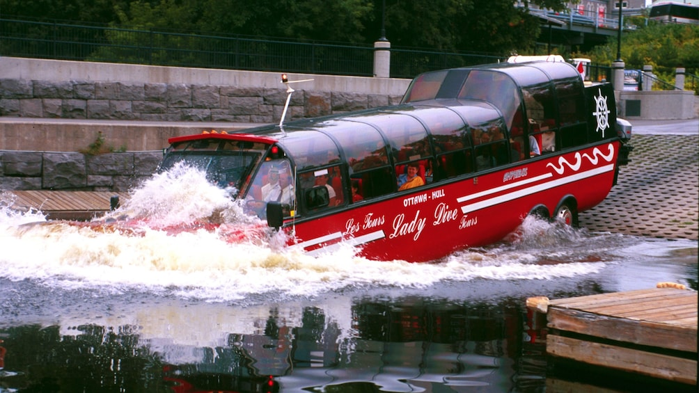 Show item 3 of 4. Amphibious bus splashing into the Ottawa River