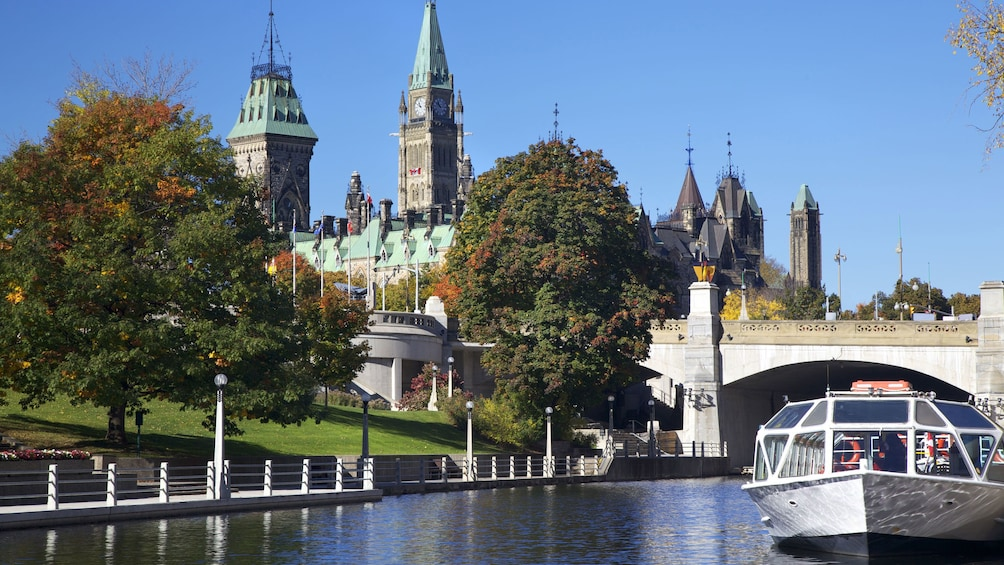 Show item 2 of 4. Ottawa River and bridge near the Peace Tower and surrounding parliament buildings in Ottawa
