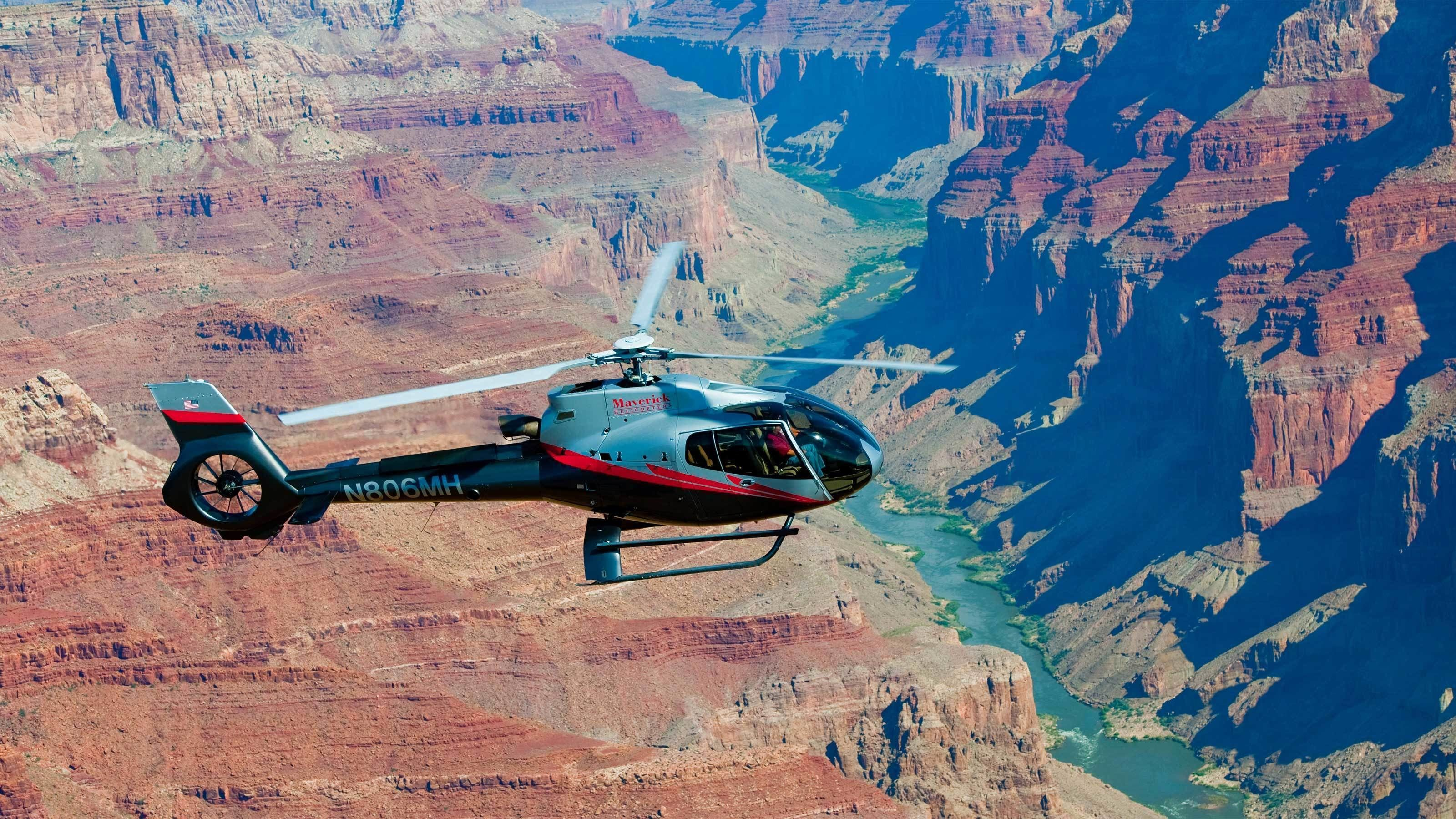 Helicopter flying above the Grand Canyon during the day