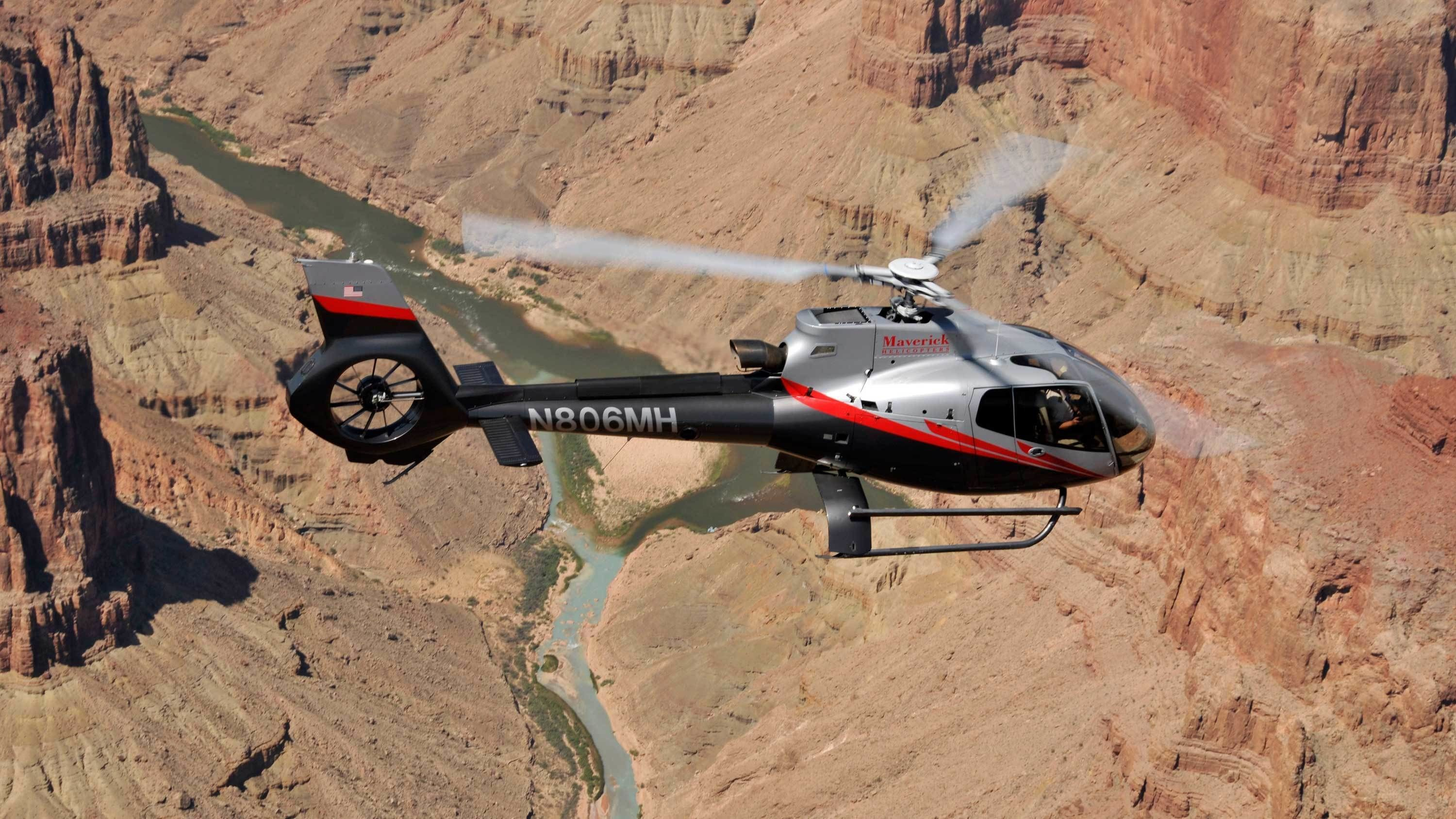Close view of helicopter flying over the Grand Canyon