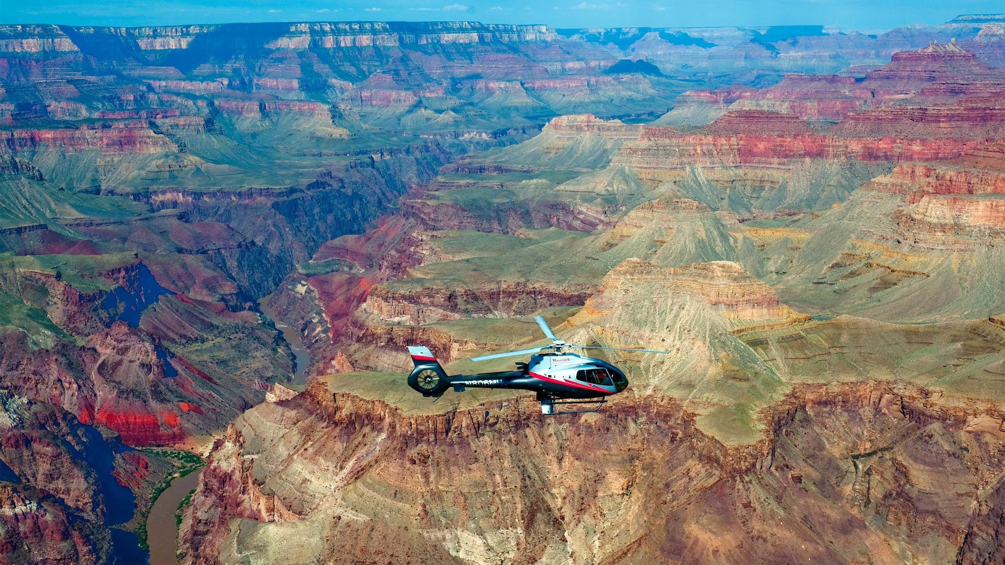 Scenic view of a helicopter flying above the Grand Canyon