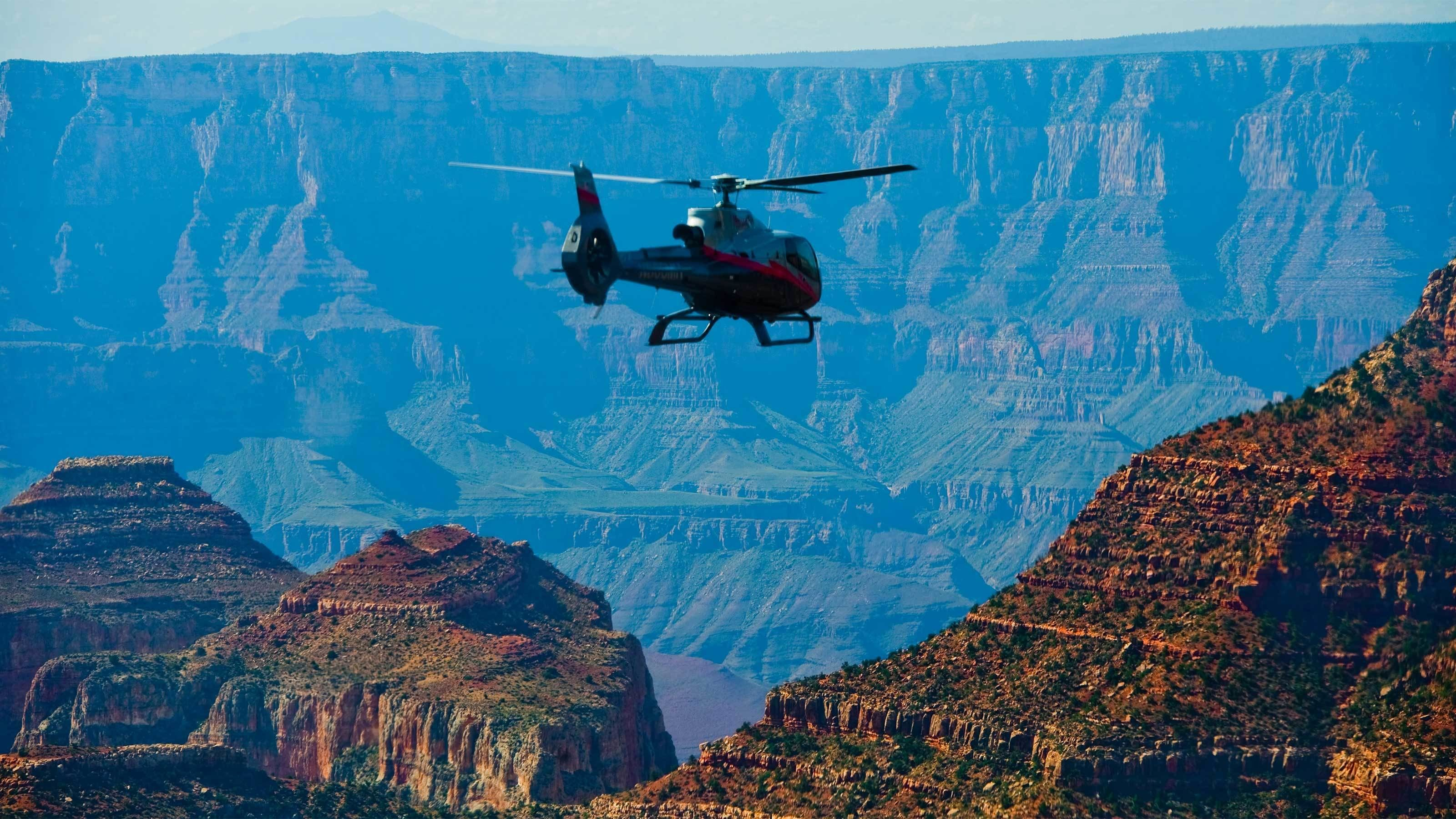Helicopter flying over the Grand Canyon during the day