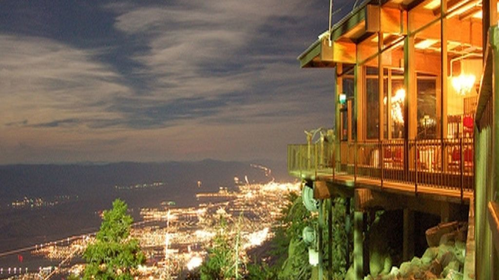 View from the Palm Springs Aerial Tram high above the city lit up at night in California