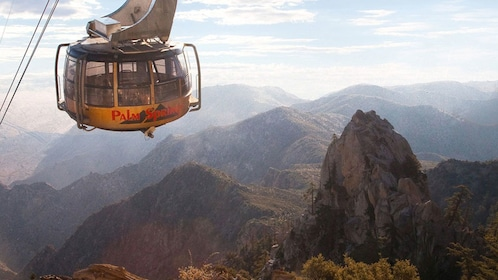 Aerial tram traveling high above the cliffs of Chino Canyon in California
