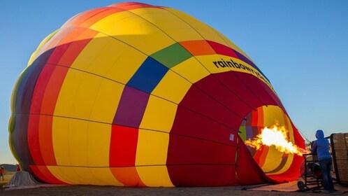 Operator inflating a hot air balloon