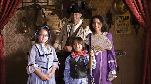Family in period clothing.