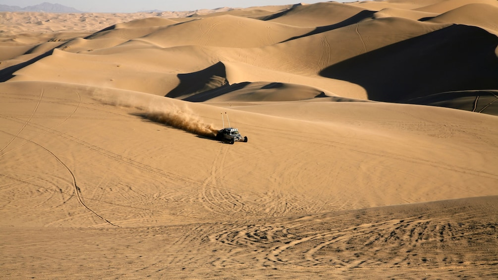 Show item 3 of 5. Dune buggy riding through the sand dunes in California
