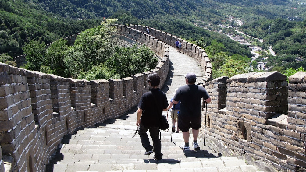 Show item 7 of 7. Visitors hiking down the Great Wall in Beijing