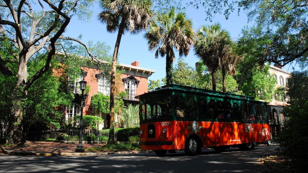 Old town trolley touring through the historic areas of Savannah, Georgia