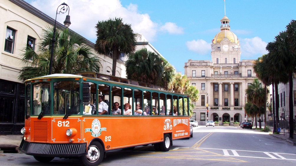 Old town trolley touring the historic district of Savannah