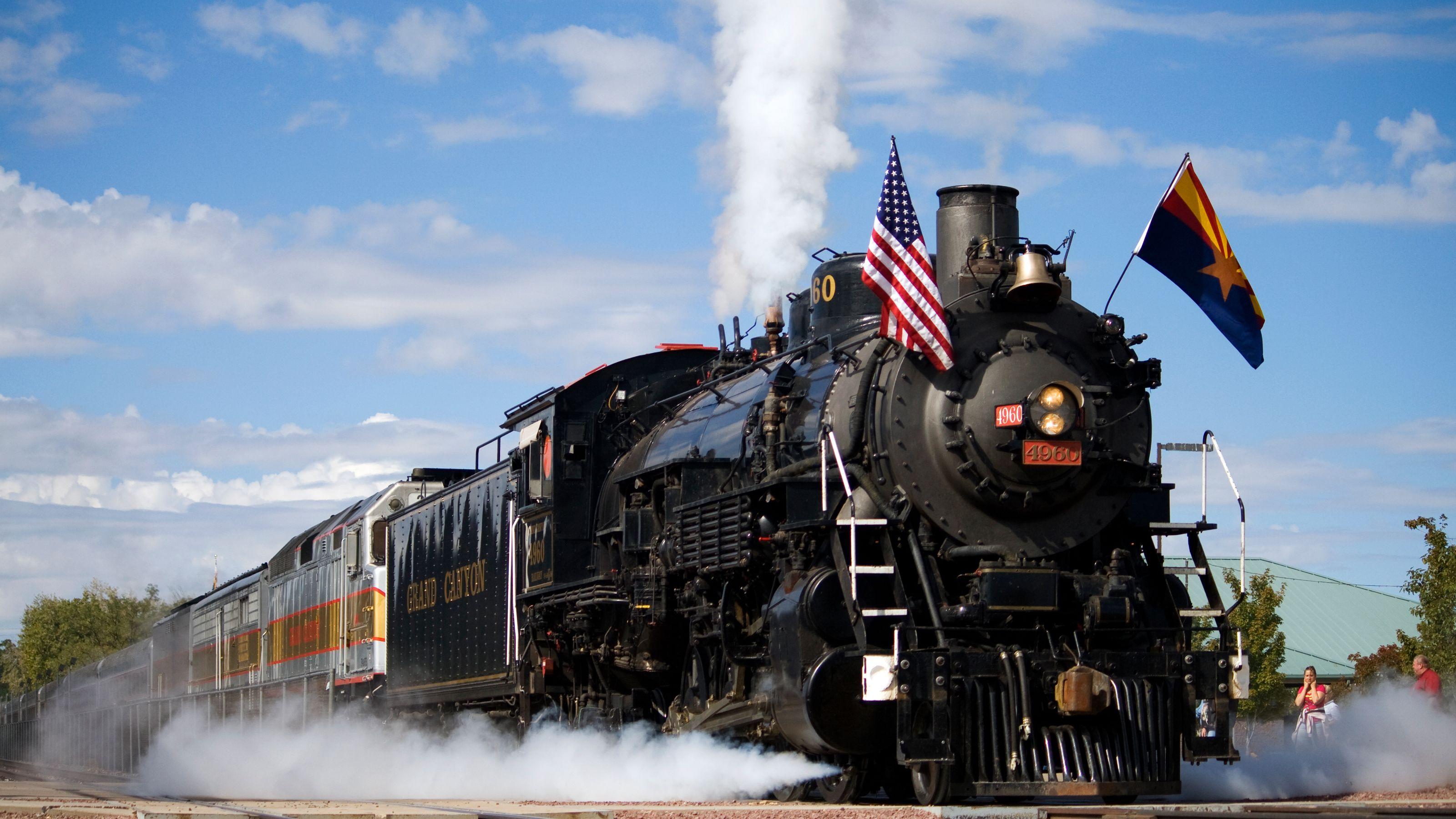 Train moving along the Grand Canyon Railway