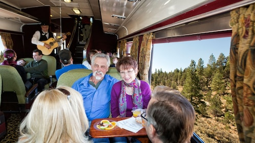 Couple smiles before enjoying a meal aboard the train in the Grand Canyon Railway