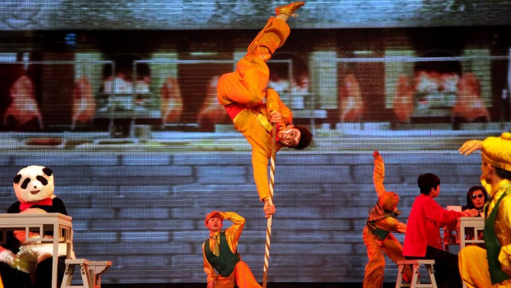 Show item 5 of 10. Performing kung fu on stage in Beijing