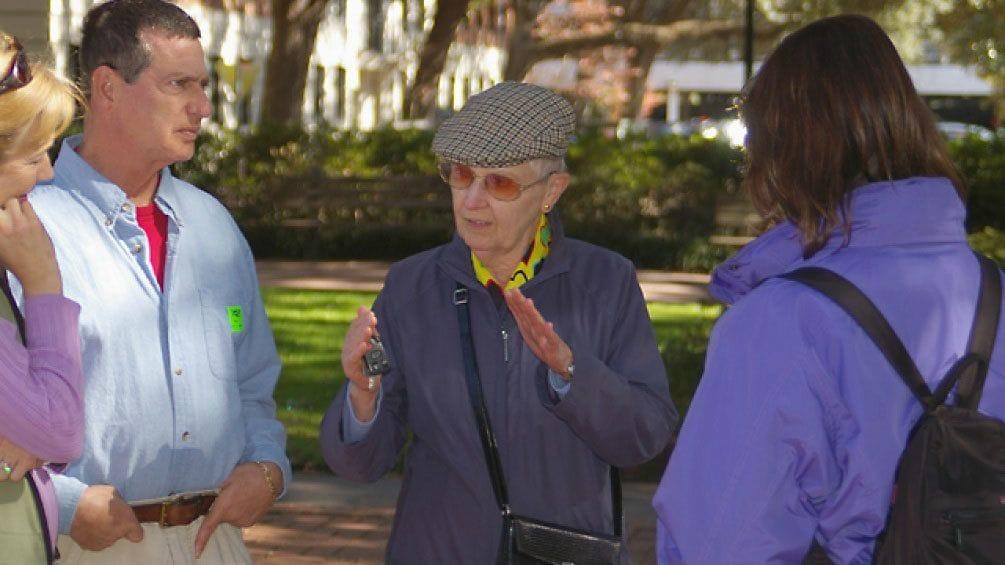 Show item 3 of 4. Historian sharing knowledge of Savannah, Georgia