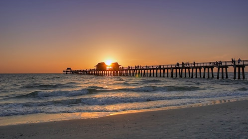 Pier at a beach in Naples at sunset