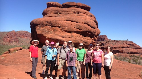 A tour group posing for photo in Palm Valley