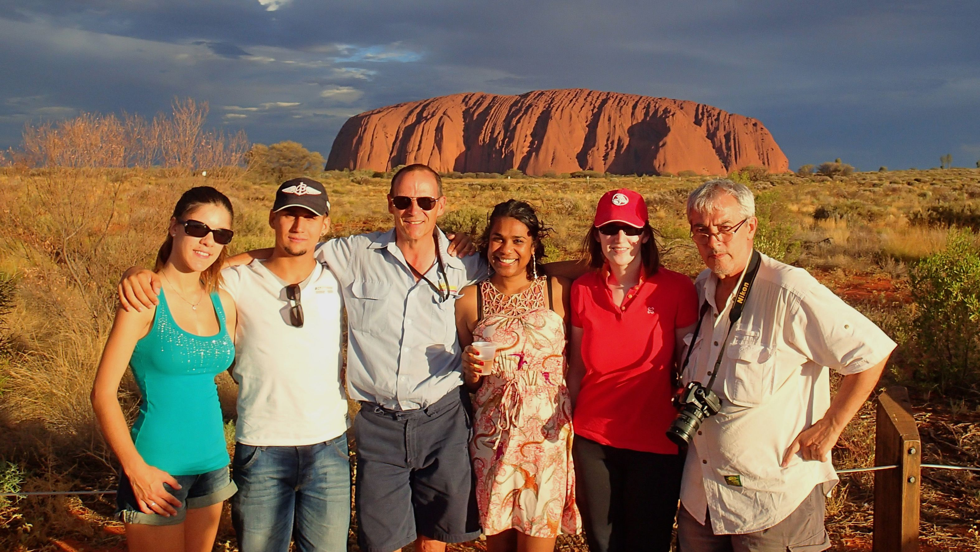 A tour group infront of Uluru