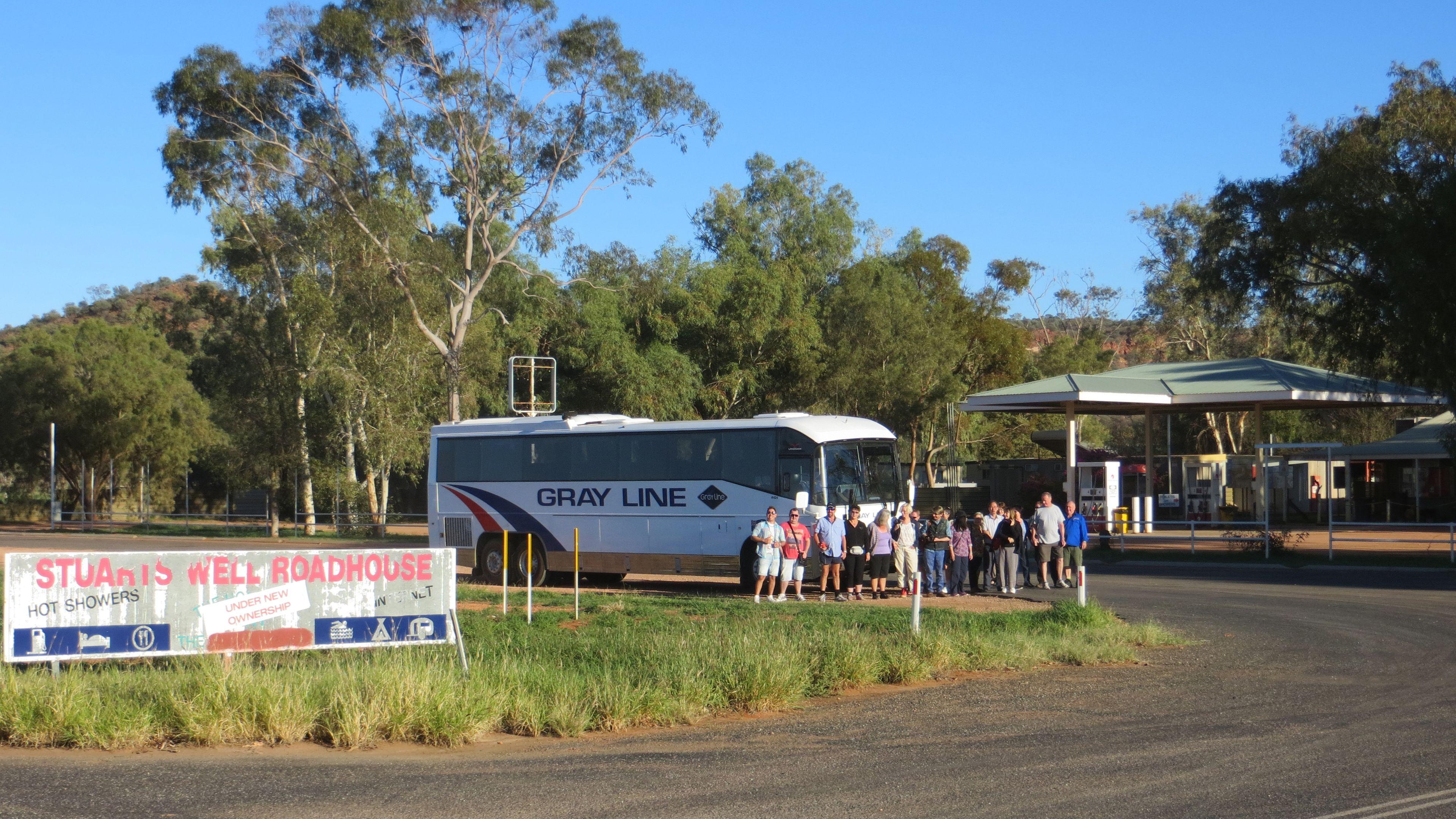 Passengers getting onto a tour bus going to Uluru