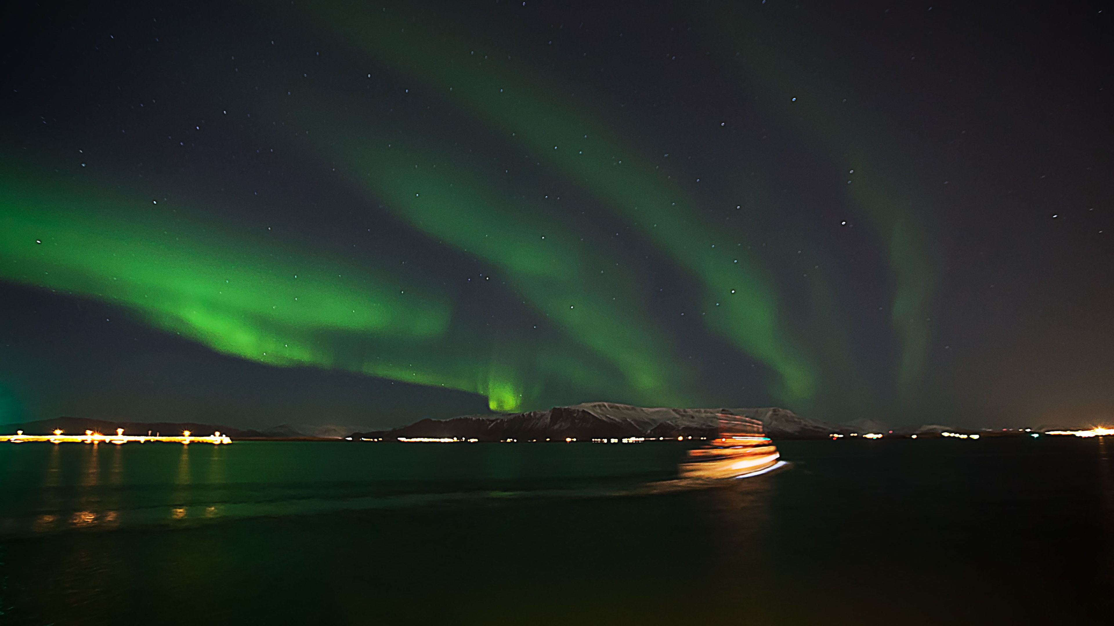 Northern Lights cruise at night in Iceland