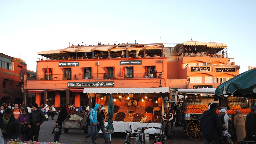 Fruit and vegetable stalls with restaurants behind in Marrakech