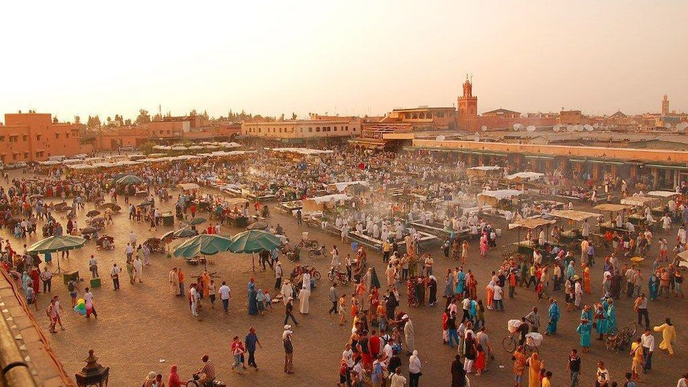 Crowded open-air marketplace in Marrakech