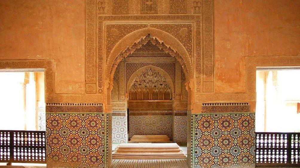 Mosaics patterns on the walls inside the Marrakech Museum