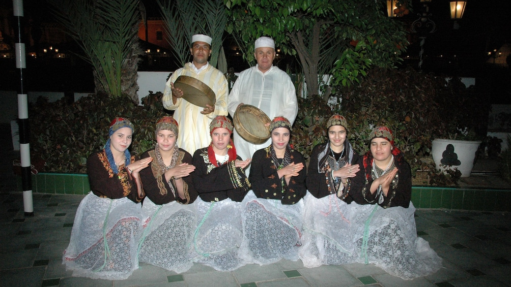 Dancers and musicians in traditional costumes in Marrakech