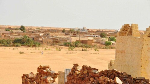 Stone ruins with city in the background in Ouarzazate