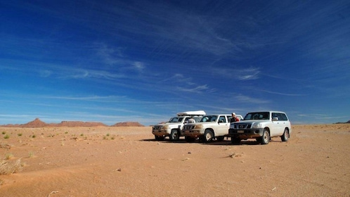 Three SUV's parked in the desert in Marrakech