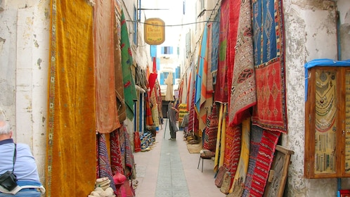 Colorful rugs hanging at a market in Marrakech