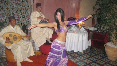 Belly dancer and musicians during a performance in Marrakech