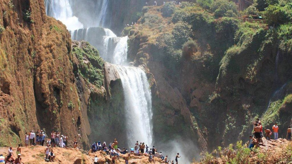 People on a lookout watching the Ouzoud Falls near Marrakech