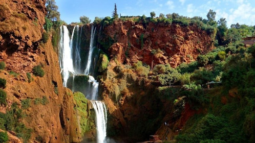 Tiered waterfalls and red cliffs of Ouzoud Falls near Marrakech