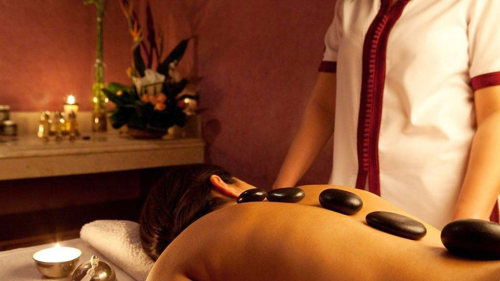 Woman with stones on her back during a massage in Marrakech