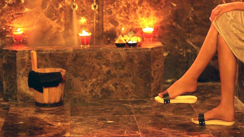 Woman enjoying a sauna with candles at a spa in Marrakech