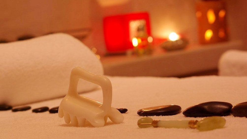 Stone massage tools on a massage table at a spa in Marrakech