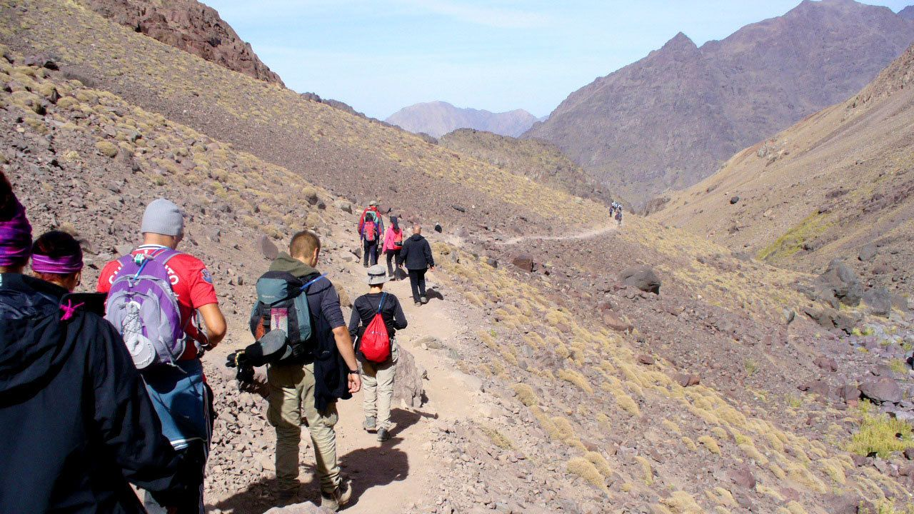 Hiking group on a trail in the Atlas Mountains in Marrakech