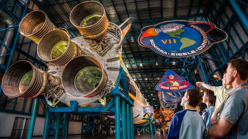 Family looking up at space shuttle inside Kennedy Space Center