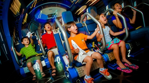 Adults and children in a 4D theater experience at Kennedy Space Center