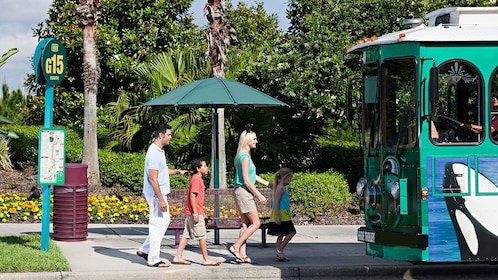 Family boarding a Hop-On-Hop-Off trolley in Orlando.