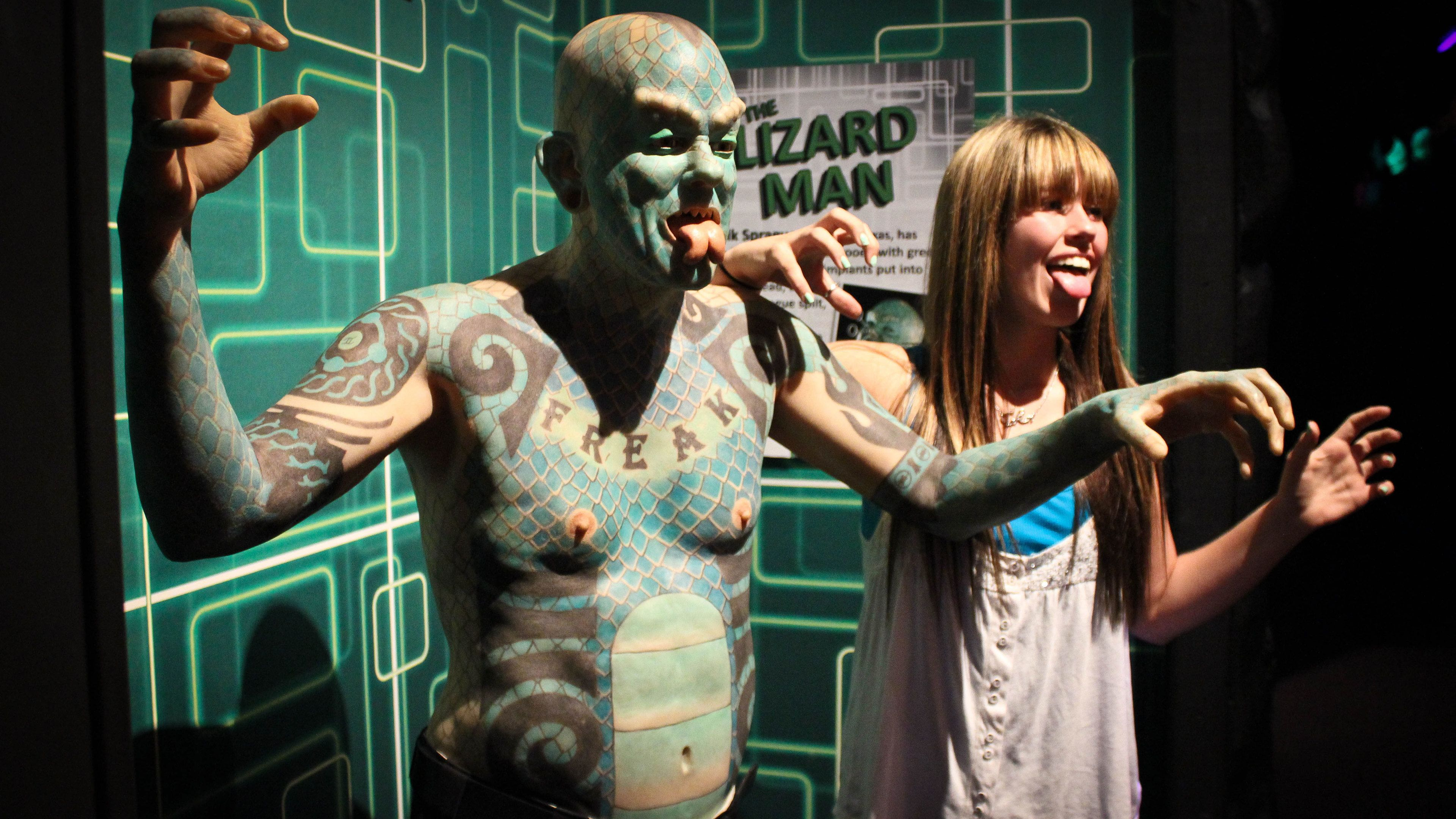 The Lizard Man exhibit with girl in Orlando.