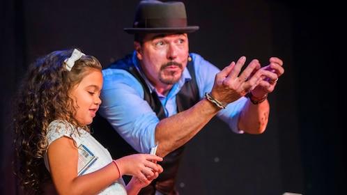 Girl assists a magician