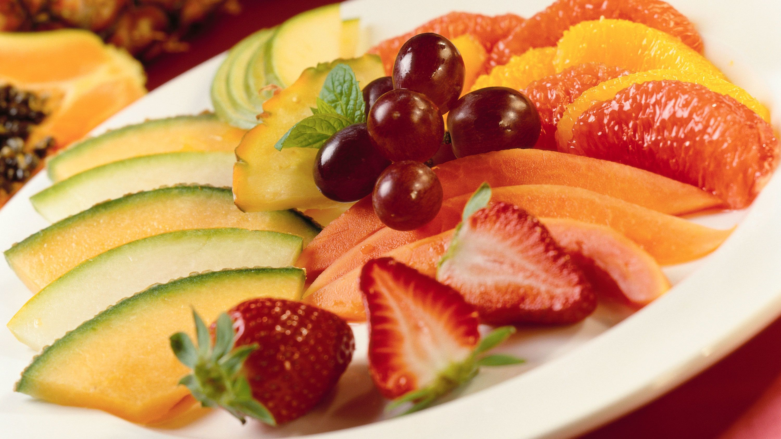 Assortment of fresh fruit on a plate.