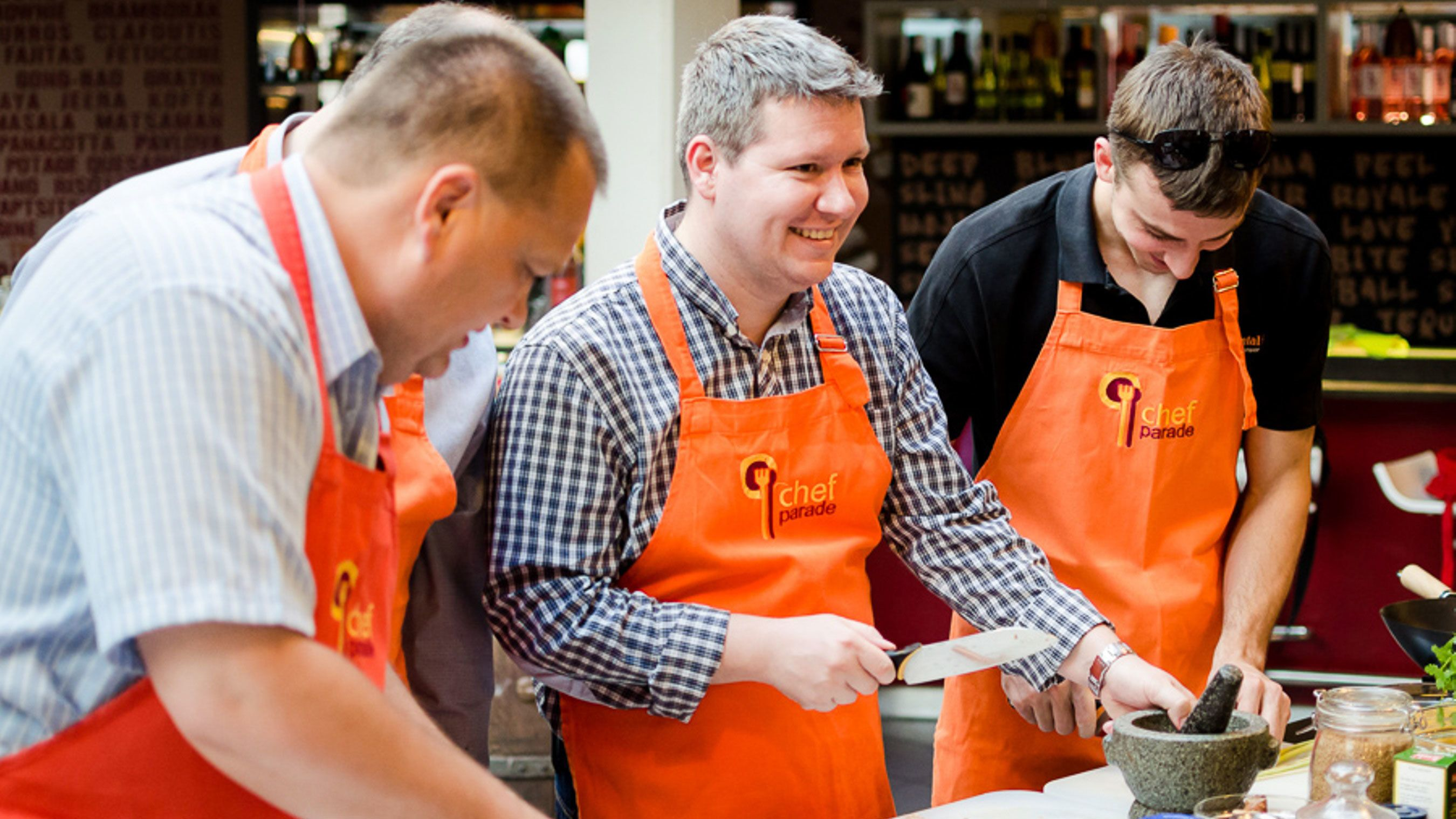 Three men preparing a dish at the Hungarian Cooking Class in Budapest